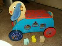 Wooden ride on with shape sorter