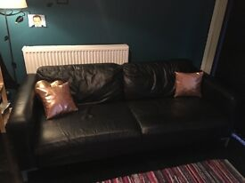 Large black leather two seater sofa