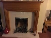 Wooden fire surround and hearth