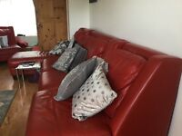 Red Leather sofas , good condition , no rips or tears