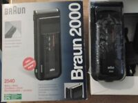 Braun rechargeable shaver, brand new in Box.