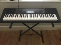 Casio keyboard on stand