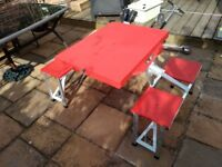 Red folding lightweight picnic table