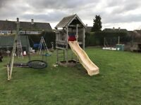 Wooden play house , climbing frame, slide, swing and monkey bars. Good condition 2 years old
