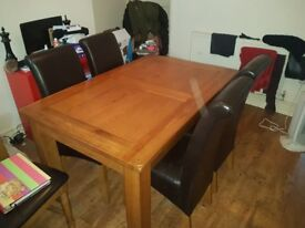 Nearly new table&chairs, 4leather chairs and wooden extending table excellent condition.