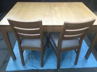 Extending Dining Table & 6 Chairs - Good Condition other than a mark on table top