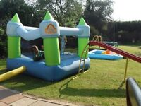 Kids bouncy castle with pug in blower