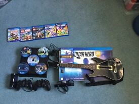 PlayStation 4, 2 x controllers, guitar hero, PS4 camera and 11 games