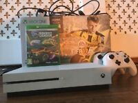 Xbox one s in good condition with two working controllers and 5 games