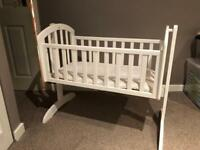 White wooden rocking crib