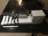 Wii console with 11 games and 3 remotes