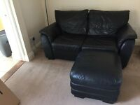 Black 2 seater sofa, electric reclining chair and footstall with storage
