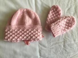 Brand new hand knitted baby's hat and mittens