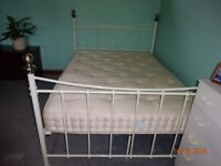 White Metal Bed Frame with spherical silver finials on each bed post.
