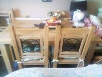 Solid oak table and chairs (heavy)