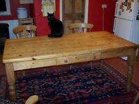 Large pine kitchen table with 2 drawers.