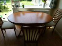 Large extendable dining table with 3 chairs