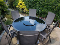6 seater round table & chairs patio set. £200. Collection only