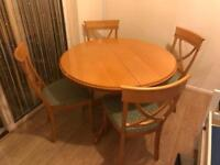 Oak round extendable table with 4 chairs very solid and good condition