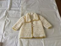 Hand made baby jacket in cream