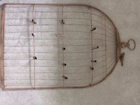 Wedding seating plan display - shabby chic metal 'birdcage' and vintage wooden pegs