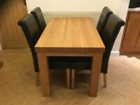 Solid oak dining table (4 free chairs, but optional)