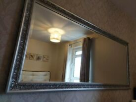 Large baroque style silver mirror