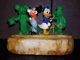 Donald duck and Mickey mouse gardeners