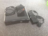Xbox 360 slim with lots of games + wired controller