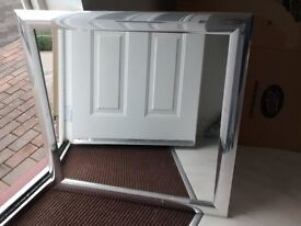 30inches by 30inches, Silver Framed Mirror. Never used been in storage.