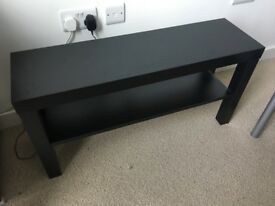 Small table used for TV. No damage, as new. Can disassemble if needed.