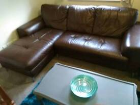 Brown leather corner sofa,foot stool and seivel arm chair