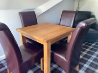 Oak extending Dining Table, 4 Oxblood Leather Chairs