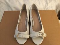 Pair of White leather sandals made by Lotus Size 5