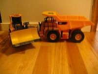 2 ELECTRIC C.A.T CONSTRUCTION PLAY TRUCKS W BATTERIES