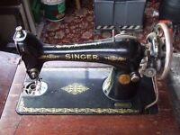 Old Singer sewing machine with manuals