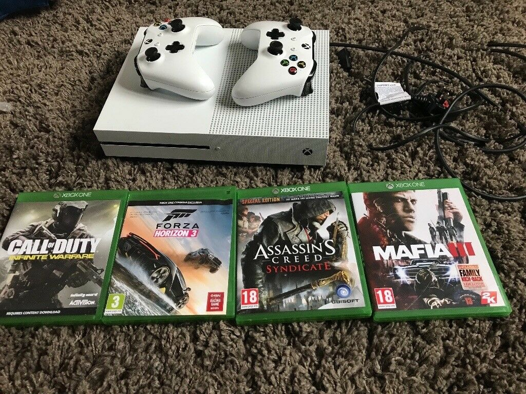 Xbox One S with two controllers and four games