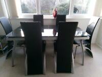 Black extending glass dining table & 6 chairs