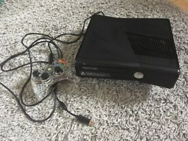 Black Xbox 360 with afterglow wired controller