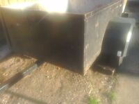 A car trailer 4half feet x3feet 2inchers 20inchers high rear lights