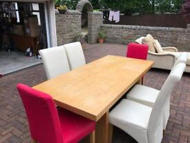 Wooden dinning room table and 6 chairs (excellent condition)