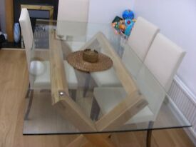 Nearly new glass top dinning table