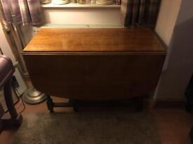Antique solid oak drop leaf dining table