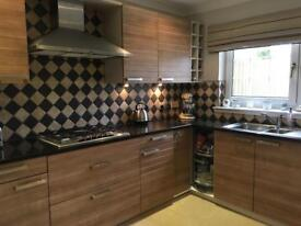 ALNO fitted kitchen with NEFF appliances, black granite worktops and BLanco sink and tap.
