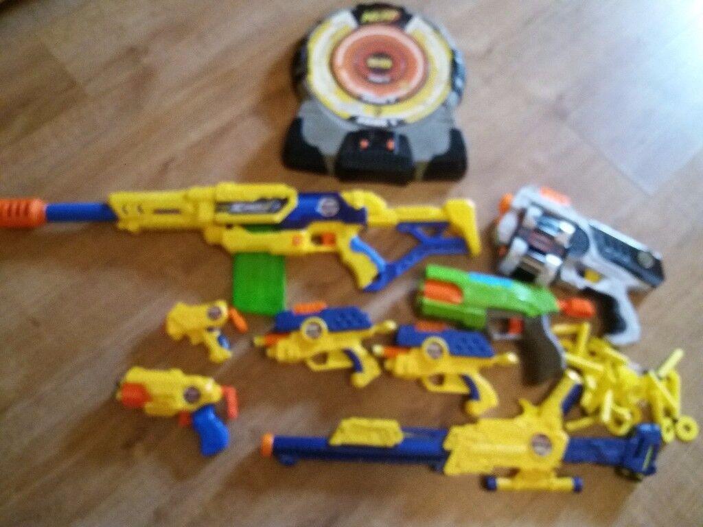 Toy guns with bullets and nerf board used but excellent condition as only used few times