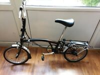 Folding bike Brompton M3L with rear carrier and dynamo
