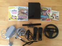 Nintendo Wii Black edition - 5 games - Wii motion PLUS controllers - Nunchuk - Steering Wheel