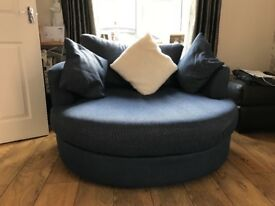 Next swivel chair, blue with a faint stipe going through.excelent condition