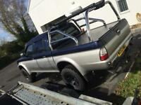 Mitsubishi l200 custom roll bars and flatbed roller shutter for sale need gone today