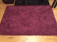 Purple rug new in bag